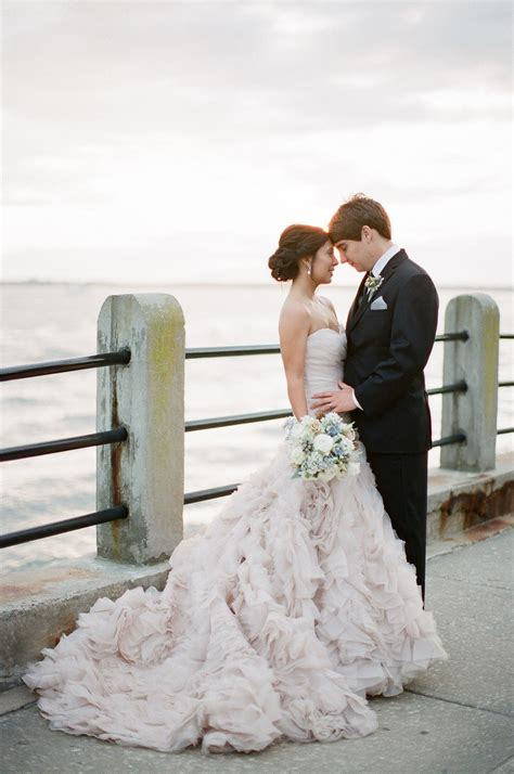 Classic Bride Wears Allure Couture Wedding Dress Poses