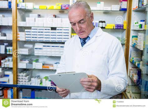 pharmacy ls for reading pharmacist reading prescription at pharmacy royalty free