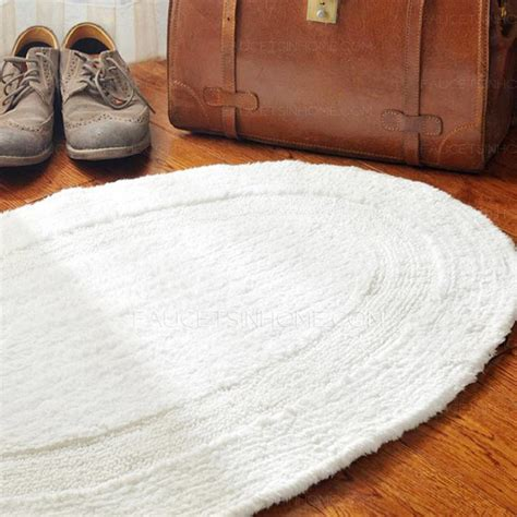 simple white oval shaped   bathroom rug