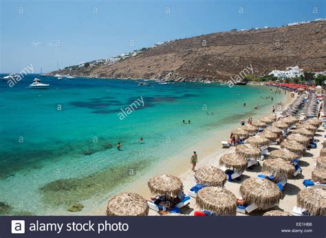 Thatched Umbrellas On Ornos Beach On Mykonos The Cyclades