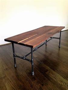 the riverside coffee table is made from thick rough cut With rough wood coffee table
