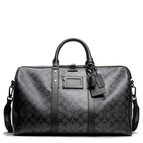 duffle bag lyst coach bleecker monogram duffle in signature coated canvas in black for