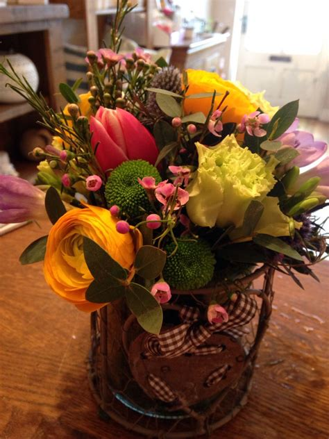 Spring arrangement in rustic heart holder #ranunculas #