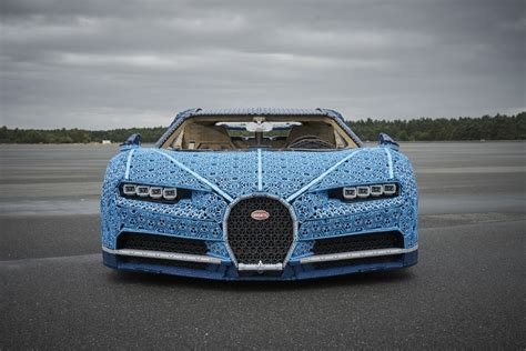 Lego says the car can accelerate to slightly over 12 miles per hour (theoretically two batteries in the car serve as its overall power source. LEGO Unveils Full-Size, Driveable Bugatti Chiron - autoevolution