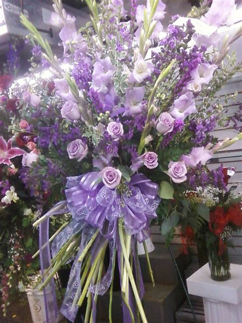 shades  lavender  purple flowers   funeral spray