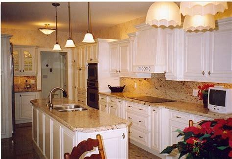 granite countertops with white kitchen cabinets white kitchen cabinets and granite countertops design 8339