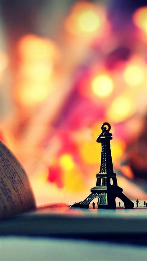 Eiffel tower people books bokeh miniature writing ...