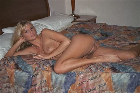Hot Blonde Milf Posing Naked On The Bed Mom Porn Photo