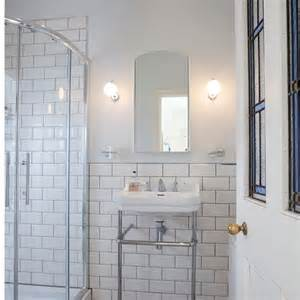 white tile bathroom with accent colors resolve40