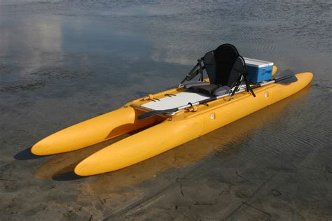 Small Fishing Boat Hull Design by Innovative Expandacraft Turns Small Boats Into Trimarans