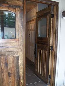 hand crafted barn wood front doors and interior door by With custom made interior barn doors