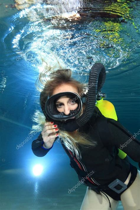 vintage scuba woman stock photo  aquanaut