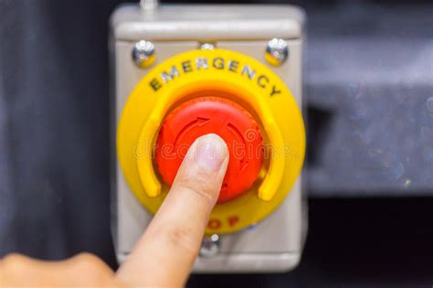 red emergency button  stop button  hand press