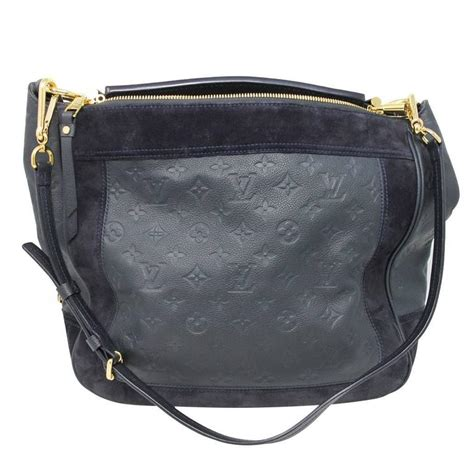 louis vuitton audacieuse navy blue suede empreinte leather handbag  stdibs