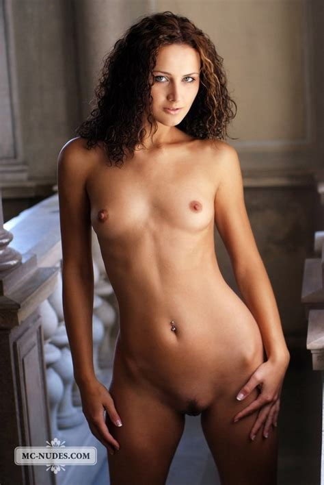 Slim Erotic Babe With Curly Hair