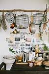 hanging kitchen basket pinner: A boho kitchen vignette   Hanging wire basket and