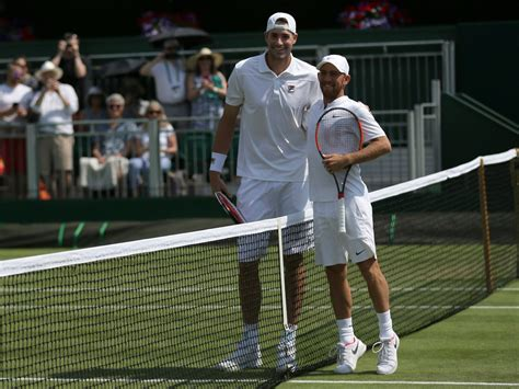 fantastic photo shows john isner dudi sela height difference  wimbledon business insider