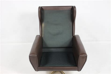 Vintage Leather Swivel Armchair By Georg Thams