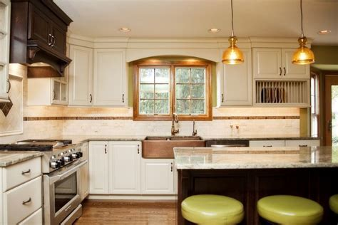 Hint of green: two tone kitchen with copper accents