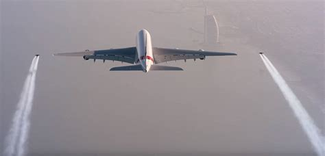 Jetpack daredevils fly beside an Emirates Airbus A380 over ...