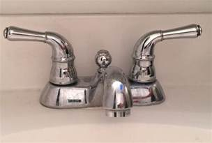 how to remove an kitchen faucet bathroom fixtures how to remove the handles from this faucet home improvement stack exchange