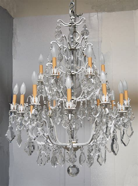 unique chandelier on a white painted frame for