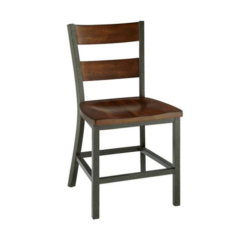 rustic hammered metal chair with flyspecking worm holes