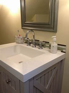 30 amazing ideas about framing a bathroom mirror with for Bathroom sink tile backsplash ideas