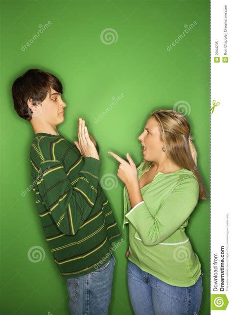 teen boy  girl fighting royalty  stock photo