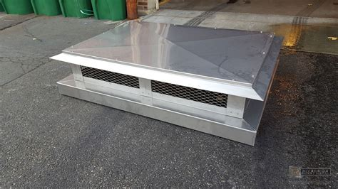 Stainless steel chimney cap with angled detailed roof   #CH001