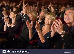 Enthusiastic audience clapping in theater Stock Photo ...