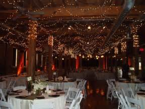 beautiful winter wedding reception venue with sparkling lights all around onewed com