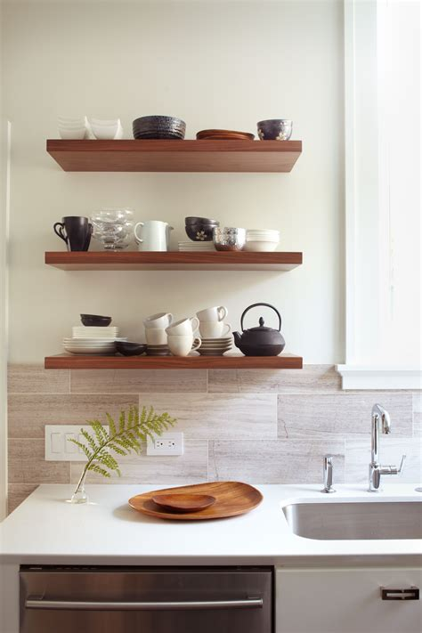 Kitchen Mantel Decorating Ideas - sublime oak wood wall floating shelving units above cabinet with white ceramic countertop and