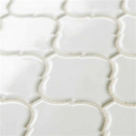 white arabesque tile earthy and colorful 1970s style wall and floor tile