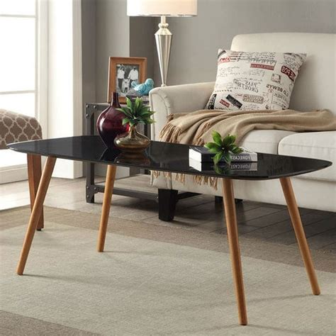 Sand the wood to make it as smooth as it could get. Modern Classic Mid-Century Style Black Top Coffee Table with Solid Wood Legs | FurnishingsPlace.com