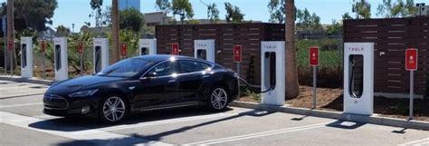 tesla passes  supercharger sites   percent