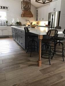 White And Dark Wood Cabinets And Chairs In A Modern