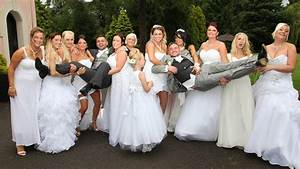 Gay couple39s wedding has 10 bridesmaids all in white for Gay wedding dress