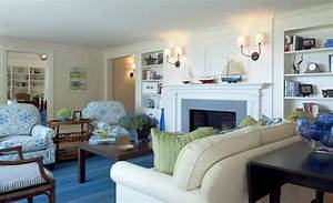 Living Room With Cream Walls  And Blue  U0026 Green Furnishings