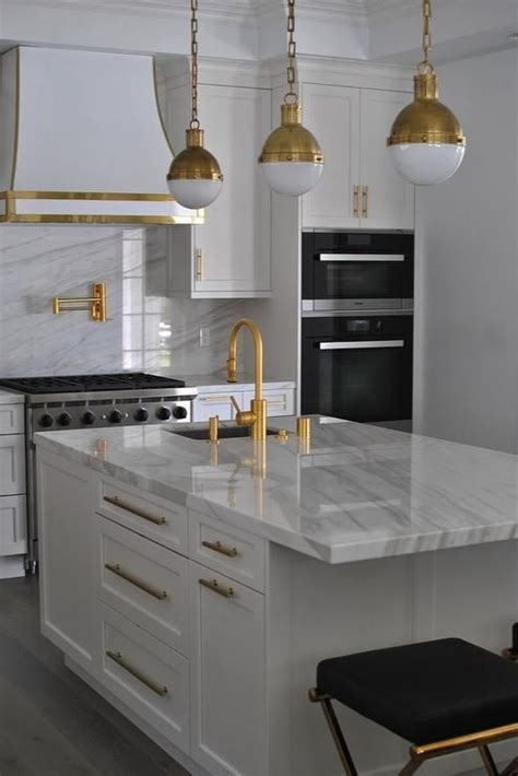 white kitchen  gold accents contemporary kitchen