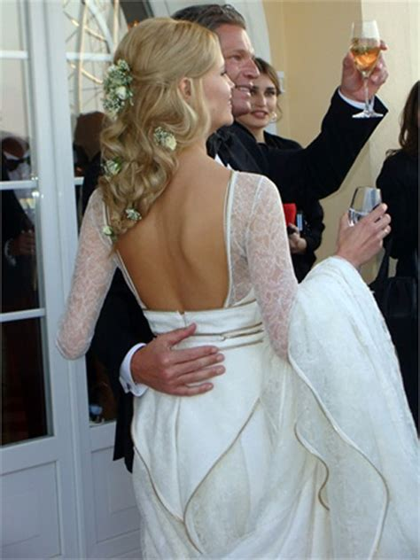 natasha poly  married wearing white givenchy wedding