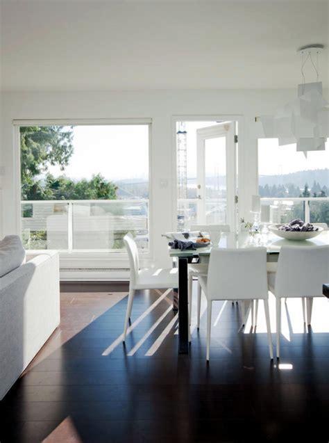 White living room furniture with dark wood floors