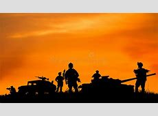 Silhouette Of Military Soldier Or Officer With Weapons At