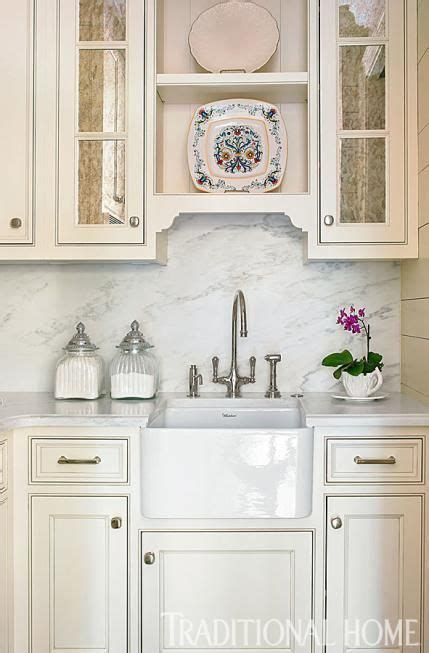 A butler's pantry with a sink serves as a breakfast bar