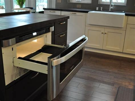 kitchen island with microwave drawer pull out microwave drawer in warm brown kitchen island