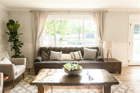 cozy living room  gray sofa large picture window hgtv