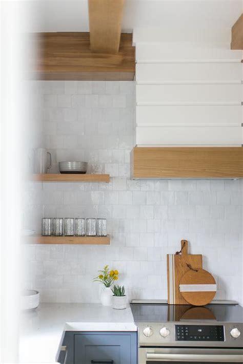 blond floating shelves  shiplap walls transitional kitchen