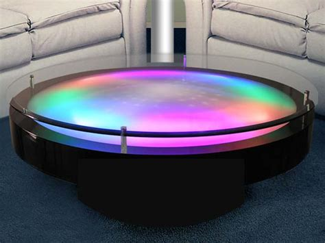 Having an ultra modern designed coffee table will add difference to the living or the dinning room. LED Illuminated Cocktail Tables With Different Effects | DigsDigs