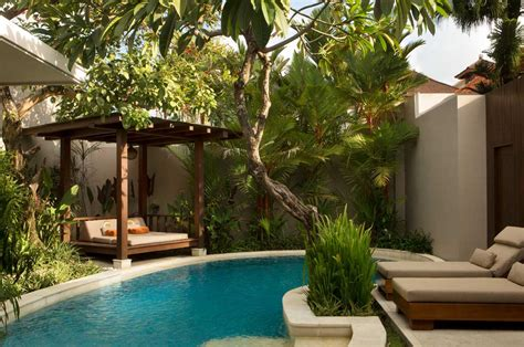 bali style small garden swimming pool design with a gazebo