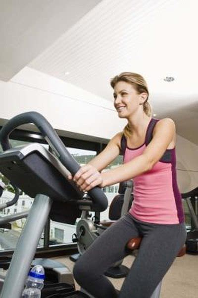 lose  lbs   stationary bike woman